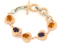 Gold Jewells: Bronze and steel bracelet with hearts