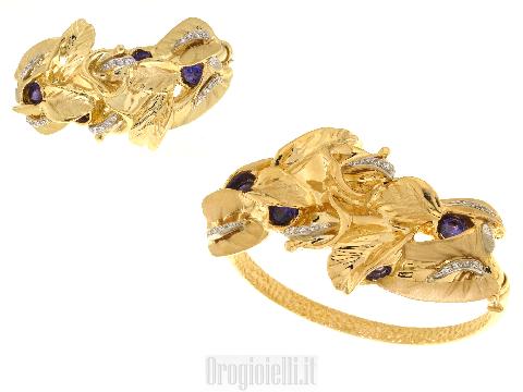 Bracciale rigido in oro e pietre
