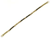 Caucciù ed oro giallo
