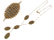 Gold Jewells: Gold necklace with black and yellow scar