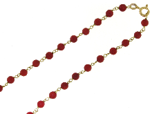 Gold Jewells: Necklace of coral beads with gold