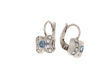 Gold Jewells: Gold earrings with white topaz